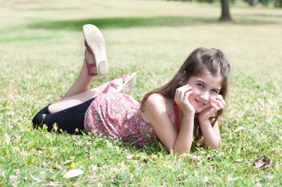 """Girl Laying On Grass Field"" by photostock"